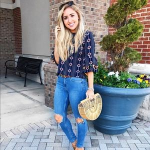 Tops - Navy pattern top with pom-pom sleeve details